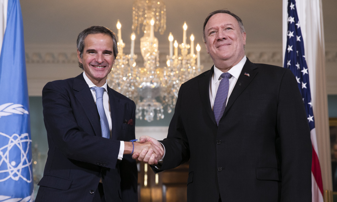 Secretary of State Mike Pompeo, right, shakes hands with Director General of the International Atomic Energy Agency (IAEA) Rafael Mariano Grossi from Argentina, Tuesday, Feb. 4, 2020, at the State Department in Washington. (AP Photo/Jacquelyn Martin)
