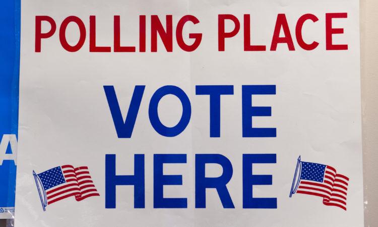 sign reading vote h ere