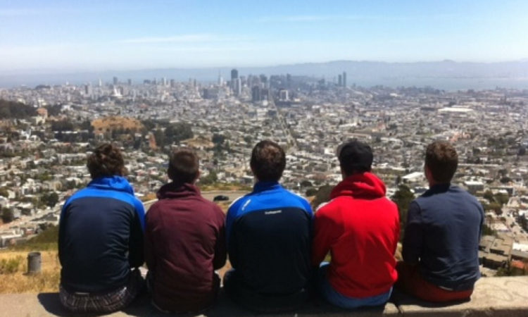 Five males overlooking a city