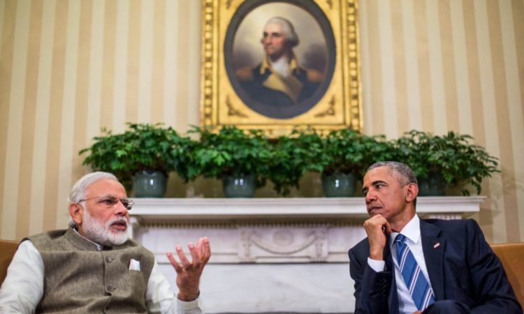 President Obama listens as Indian Prime Minister Narendra Modi speaks to media during their meeting in the Oval Office of the White House on June 7, 2016. (© AP Images)