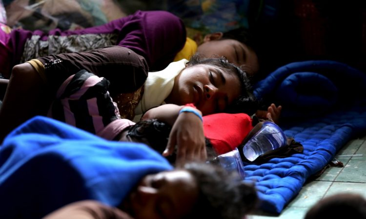 Burmese migrants sleep at a temporary shelter in Indonesia. (© AP Images)
