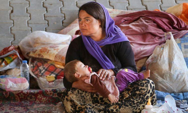 Une Irakienne et sa fille, de la communauté yézidie, une minorité ciblée par Daech. (© AP Images)