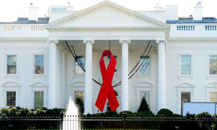 A red ribbon is displayed on the North Portico of the White House on Dec. 1, 2014, to commemorate World AIDS Day in Washington, D.C.
