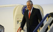 Secretary of State Rex Tillerson steps off his plane (AP Photo)