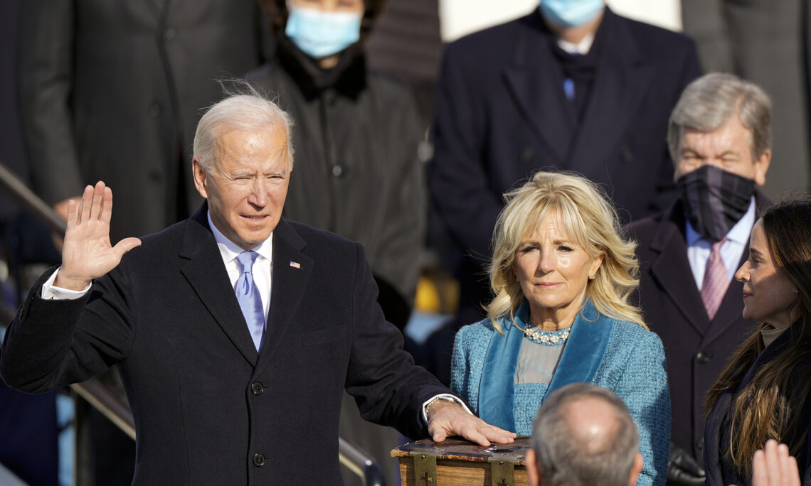 Joe Biden is sworn in as the 46th president of the United States by Chief Justice John Roberts (AP Photo/Andrew Harnik)