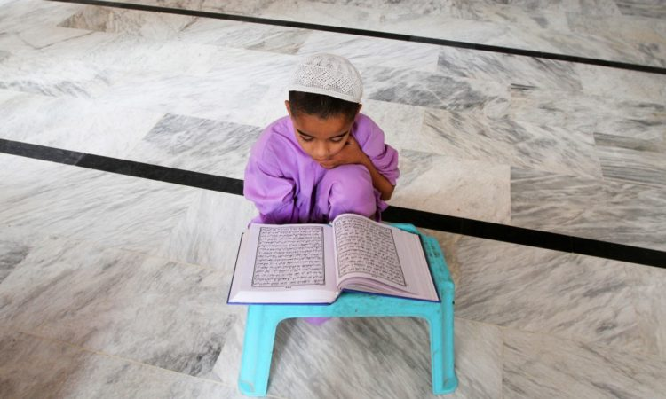 Kid praying © AP Images