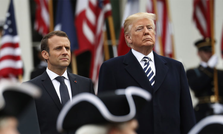 President Donald Trump and French President Emmanuel Macron stand during a State Arrival Ceremony on the South Lawn of the White House in Washington, Tuesday, April 24, 2018. (AP Photo/Pablo Martinez Monsivais)