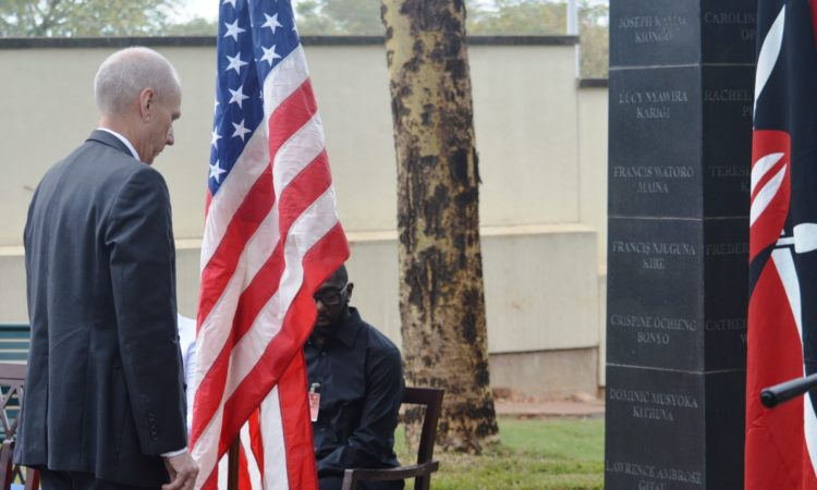 Ambassador Godec lays a wreath at the Embassy memorial.