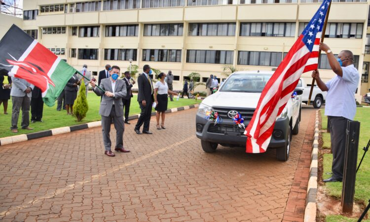 Photo 1 – Ambassador Kyle McCarter delivers 10 Toyota Hilux pickup trucks to the DCI and EACC for use by their investigators to combat corruption and drug trafficking