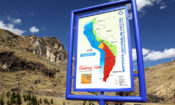 Sign for Qhapaq Nan Inca road project at the site of the last Inca suspension bridge, Canas province , near Cusco , Peru