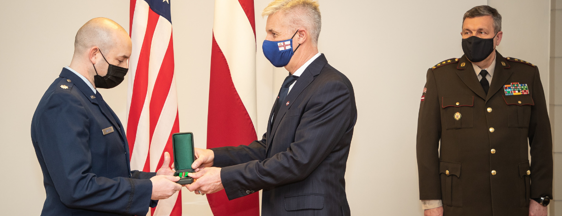 Lt. Col. Brook Sweitzer receives recognition from Latvian Armed Forces