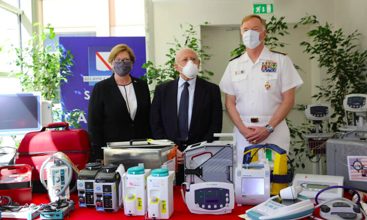 CG Avery with Adm. James Foggo, Commander, U.S. Naval Forces Europe- Africa, and President of the Campania Region Vincenzo De Luca, and some examples of the medical equipment donated