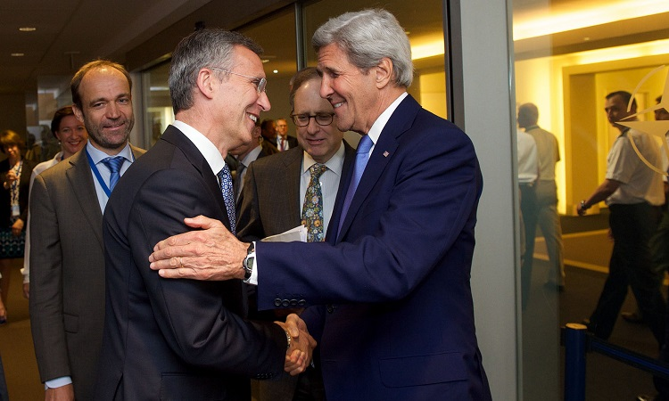 Stoltenberg and Kerry greeting (NATO)