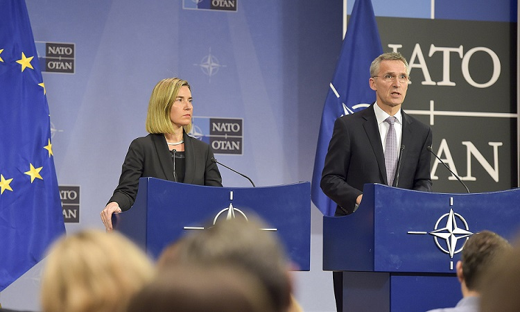 Mogherini and Stoltenberg at podium