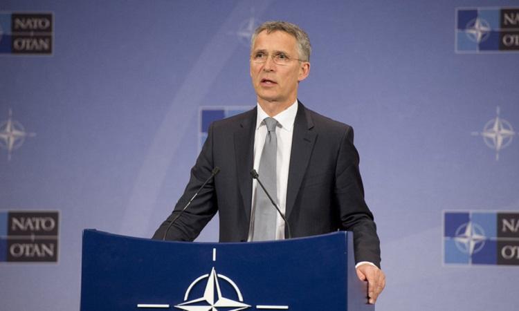 SG Stoltenberg at NATO podium