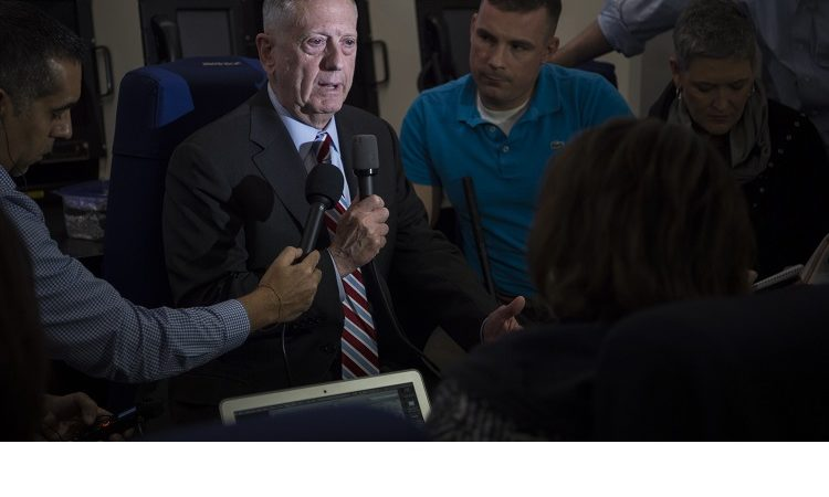 Secretary Mattis talking to press on plane