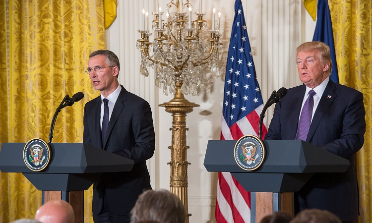 Secretary General Stoltenberg and President Trump speaking
