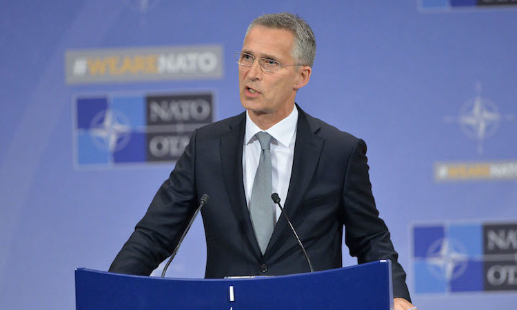 NATO Secretary General speaking at podium