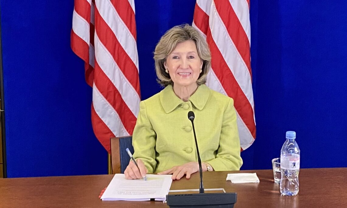 Ambassador Kay Bailey Hutchison behind the desk