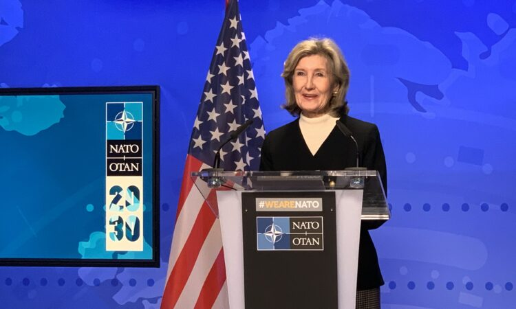 Ambassador Kay Bailey Hutchison speaking behind the podium.