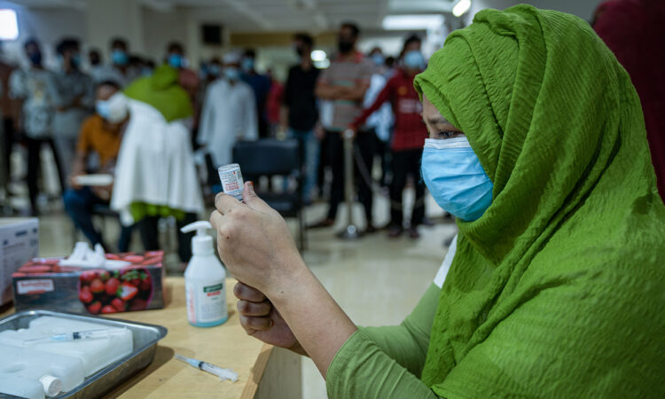 A health worker prepares to administer Moderna COVID-19 vaccine at Shyamoli TB Hospital in Dhaka. An additional $11.4 million in U.S. support for COVID-19 will bolster Bangladesh's national vaccination campaign effort, and enhance prevention and care across the country.