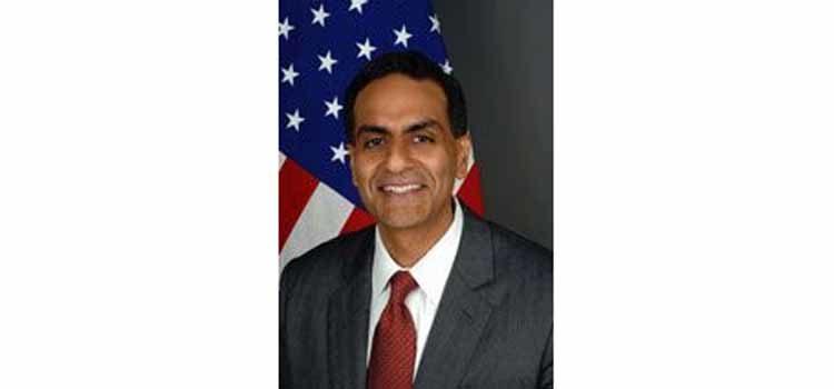 Man smiling. (Photo Credit: State Department)