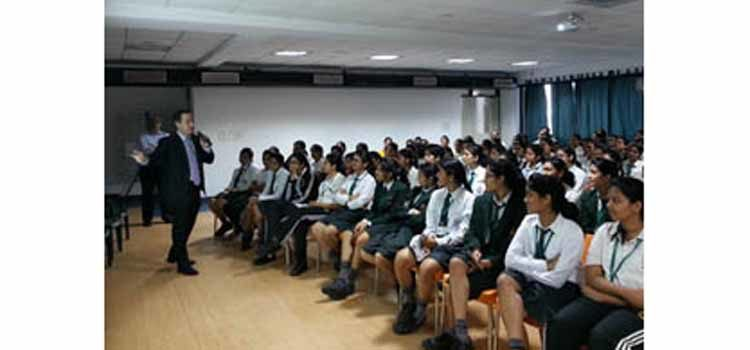 Man speaking to a group of students. (Photo Credit: State Department)
