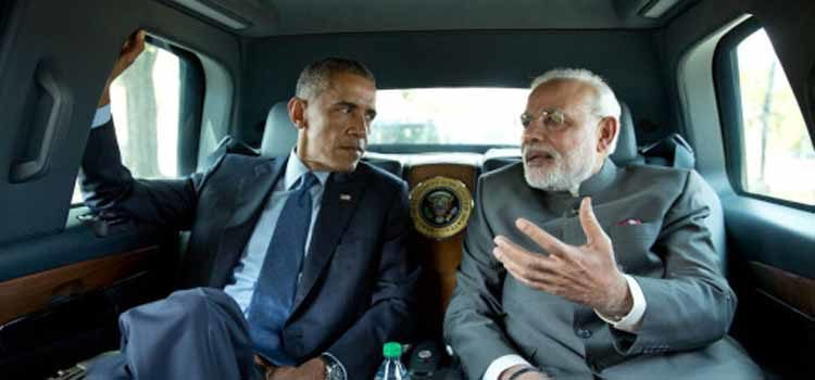 Two men riding in a car talking. (Photo Credit: The White House)