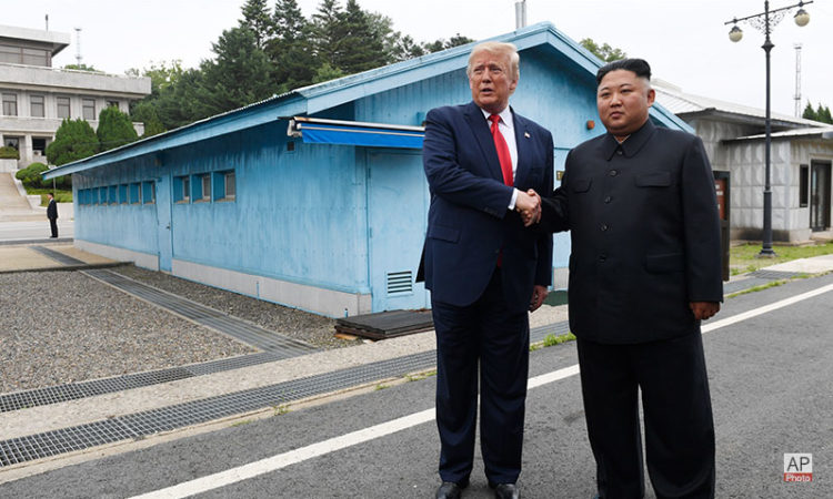 June 30, 2019 – U.S. President Donald Trump (left) meets with North Korean Chairman Kim Jong Un (right) at the Demilitarized Zone (DMZ), South Korea. (AP Photo)
