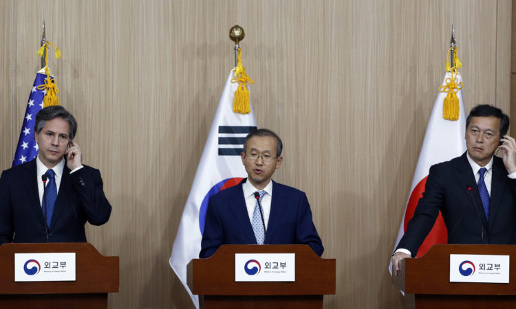 U.S. Deputy Secretary of State Antony Blinken, left, and Japan Vice Foreign Minister Akitaka Saiki, right, listen to South Korea Vice Foreign Minister Lim Sung-nam, center, during a press conference following their meeting of the third round of Deputy-level trilateral consultations in Seoul, South Korea, Tuesday, April 19, 2016. (AP Photo/Lee Jin-man)