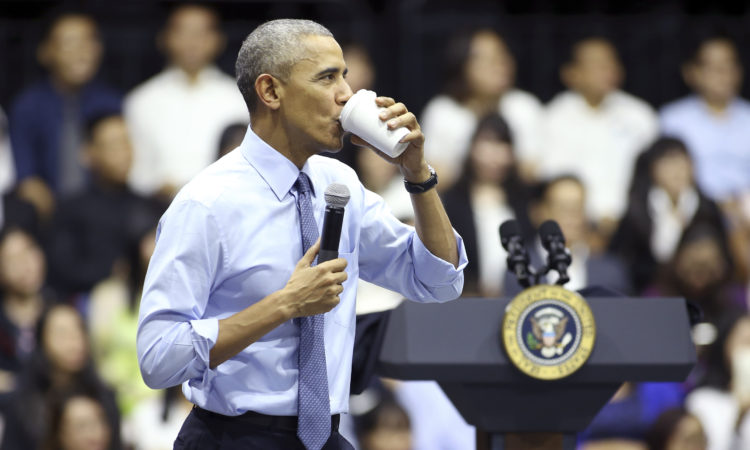 U.S. President Barack Obama drinks while speaking at a town-hall style event for the Young Southeast Asian Leaders Initiative at the GEM Center in Ho Chi Minh City, Vietnam, Wednesday, May 25, 2016. (AP Photo/Na Son Nguyen)