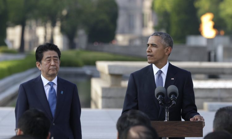 U.S. President Barack Obama, right, delivers remarks next to Japanese Prime Minister Shinzo Abe at Hiroshima Peace Memorial Park in Hiroshima, western, Japan, Friday, May 27, 2016. Obama on Friday became the first sitting U.S. president to visit the site of the world's first atomic bomb attack, bringing global attention both to survivors and to his unfulfilled vision of a world without nuclear weapons. Atomic Bomb Dome is seen in the background. (AP Photo/Carolyn Kaster)