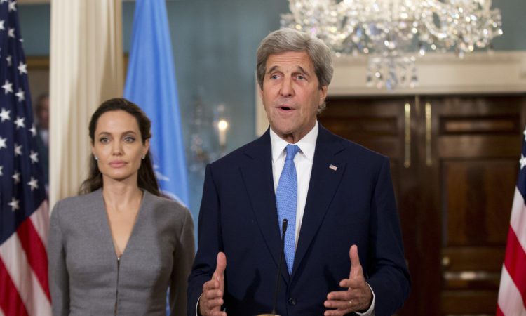 Secretary of State John Kerry with United Nations High Commissioner for Refugees Special Envoy Angelina Jolie speaks to reporters at the Department of State in Washington, Monday, June 20, 2016. Jolie called for action on World Refugee Day. (AP Photo/Manuel Balce Ceneta)