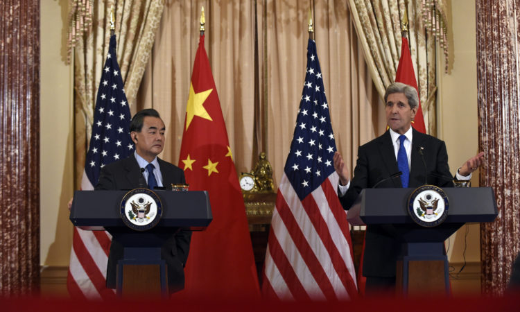 Secretary of State John Kerry, right, speaks during a media availability with Chinese Foreign Minister Wang Yi, left, at the State Department in Washington, Tuesday, Feb. 23, 2016.(AP Photo/Susan Walsh)