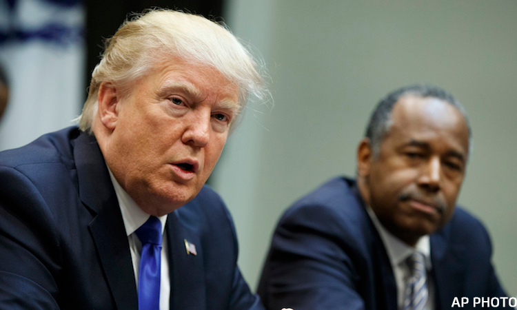 Donald Trump Nominee to lead the Department of Housing and Urban Development Ben Carson, right, looks on as President Donald Trump speaks during a meeting on African American History Month in the Roosevelt Room of the White House, Wednesday, Feb. 1, 2017, in Washington. (AP Photo/Evan Vucci)