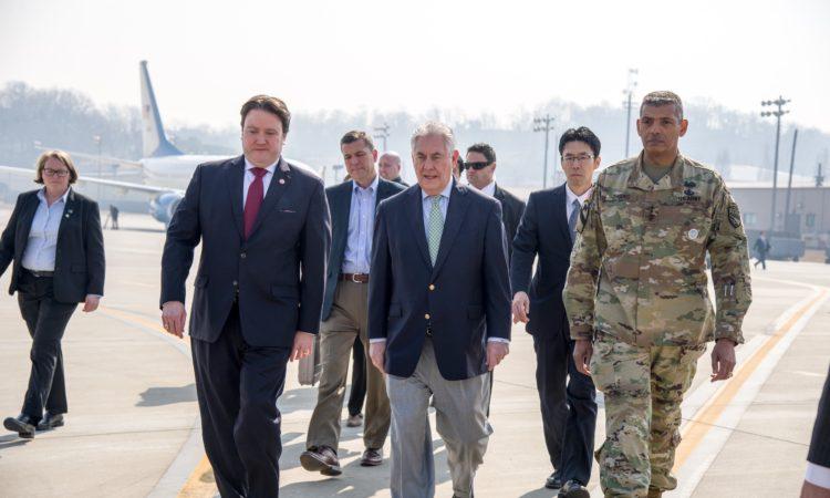 U.S. Secretary of State Rex Tillerson walks with Marc Knapper, U.S. Embassy Seoul Chargé d'Affaires ad interim, and Gen. Vincent K. Brooks, U.S. Forces Korea commander, upon arriving at Osan Air Base outside of Seoul, South Korea, on March 17, 2017. [State Department photo]