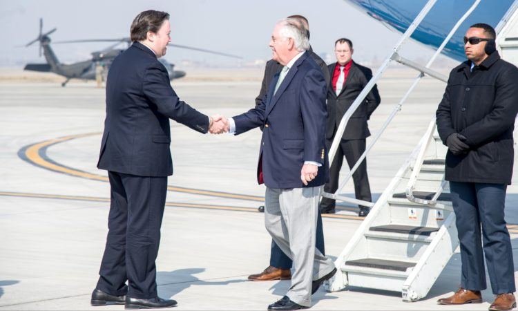 U.S. Secretary of State Rex Tillerson is greeted by Marc Knapper, U.S. Embassy Seoul Chargé d'Affaires ad interim, upon arrival at Osan Air Base in South Korea on March 17, 2017. [State Department photo]