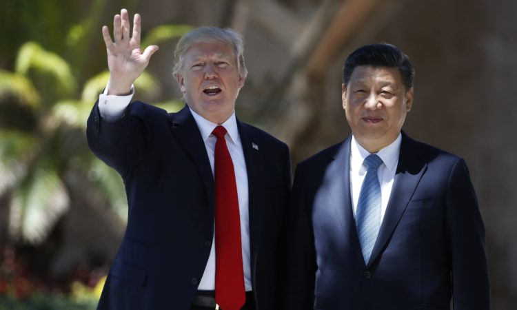 April 7, 2017 - President Donald Trump and Chinese President Xi Jinping pause for photographs at Mar-a-Lago in Palm Beach, Fla.
