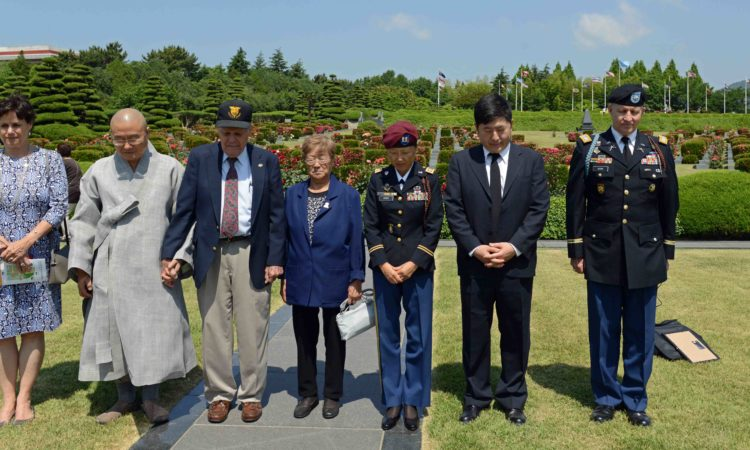 Dae Kim and American veterans observe a moment of silence to honor U.S. Korean War veterans