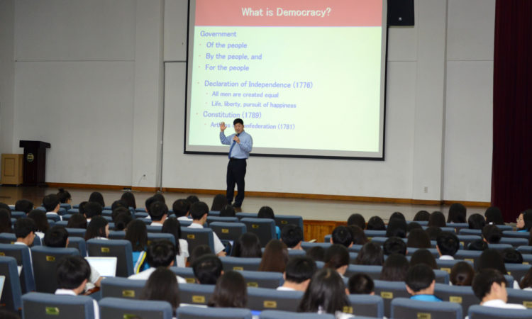 Students listen intently as Dae Kim speaks