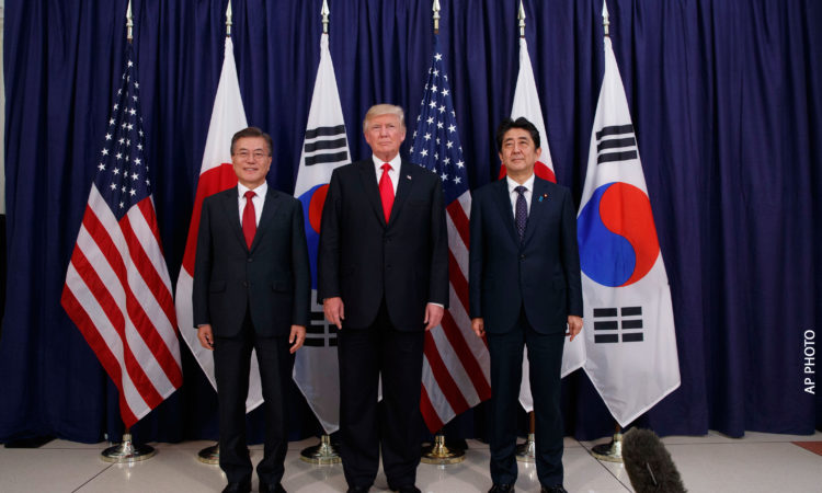 [AP Photo] President Donald Trump, center, meets with Japanese Prime Minister Shinzo Abe, right, and South Korean President Moon Jae-in before the Northeast Asia Security dinner at the US Consulate General Hamburg, Thursday, July 6, 2017, in Hamburg.