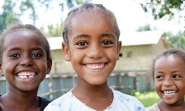Smiling primary school students in Ethiopia.