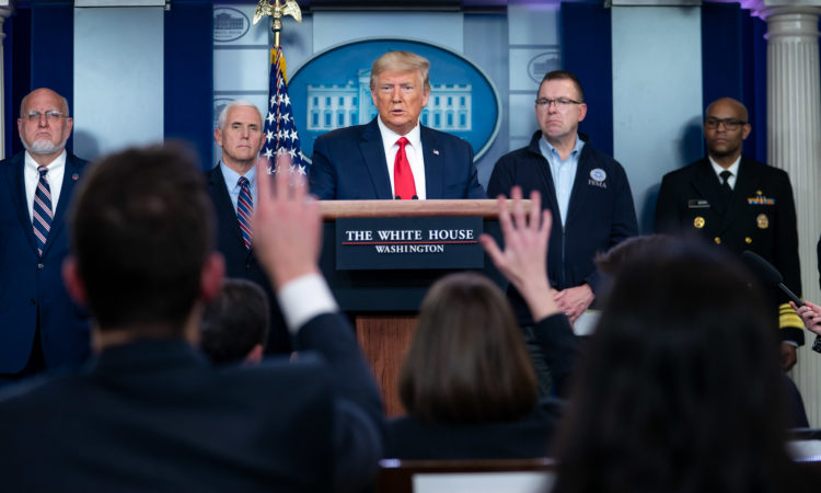 President Donald J. Trump, joined by members of the White House Coronavirus Task Force, listens to a reporter's question at a coronavirus (COVID-19) update briefing Sunday, March 22, 2020, in the James S. Brady Press Briefing Room of the White House. (Official White House Photo by Tia Dufour)