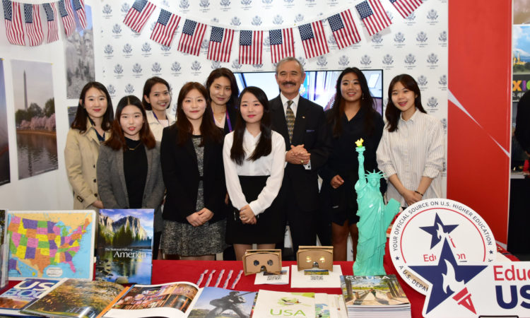Ambassador Harry Harris Visits the Embassy's EducationUSA & TravelUSA Booth