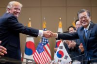 President Trump and South Korean President Moon Jae-in clasp hands at the Blue House in Seoul on November 7, 2017. (© Andrew Harnik/AP Images)