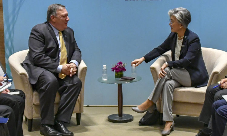 August 1, 2018 – Secretary Michael R. Pompeo speaks with Republic of Korea's Foreign Minister Kang Kyung-wha at ASEAN 2018 Singapore. [State Department Photo]