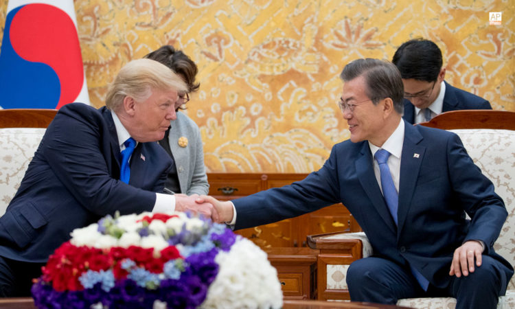 November 7, 2017 - President Donald Trump, left, shakes hands with South Korean President Moon Jae-in, right, at an arrival ceremony at the Blue House in Seoul, South Korea. (AP Photo)
