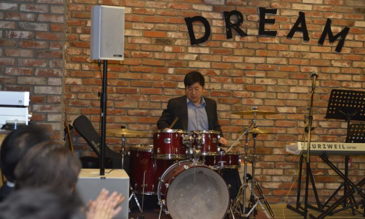 Consul Dazzles Audience with Drum Solo and Song