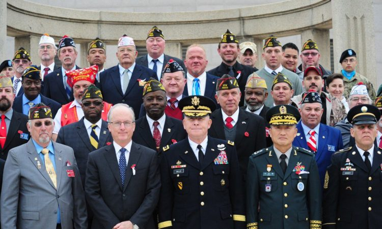November 12, 2018 – Deputy Chief of Mission Rob Rapson (1st row, 2nd from left) and Lt. Gen. Michael Bills (center), Commanding General of the Eighth Army, attended a Veterans Day ceremony at the Eighth Army War Memorial to pay tribute to veterans for their valor and to honor their sacrifices.