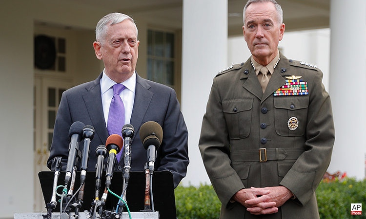 Defense Secretary Jim Mattis, left, accompanied by Joint Chiefs Chairman Gen. Joseph Dunford, right, speaks to members of the media outside the West Wing of the White House in Washington, Sunday, Sept. 3, 2017, regarding the escalating crisis in North Korea's nuclear threats. (AP Photo)